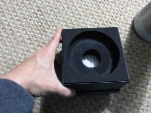 Picture of the Harman Kardon Invoke voice activated speaker, original box bottom, pedestal part, that contains the manuals and power adapter.