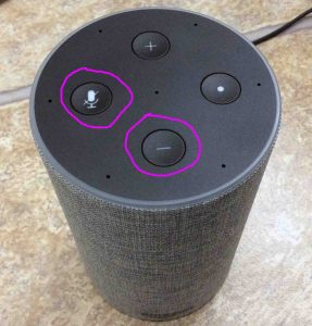 How to reset Amazon Alexa Echo Gen 2. Picture of the Amazon Echo Gen 2 smart speaker reset button location. It's a button combination of the Mic Mute and Volume Down buttons, as circled in purple