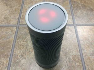 Picture of the Harman Kardon Invoke smart ppeaker, requesting a reset, by showing its red lights rotating.