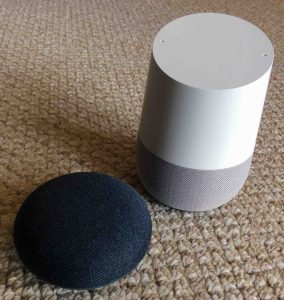 Picture of the Google Home Mini and Original smart speakers. All Google Home speakers can play AAC files and streams also.