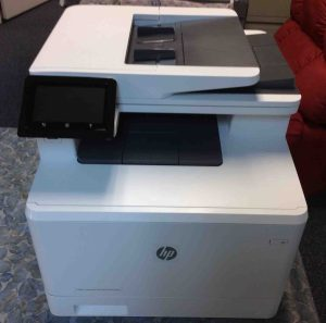 Picture of the HP Laserjet Pro MFP M477 printer, front view, fully unboxed.