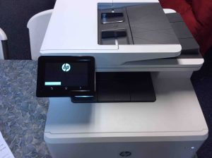 Picture of the Laserjet Pro M477 printer, showing its control panel screen during booting.