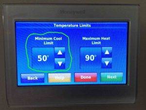 Picture of the Honeywell RTH9580WF WiFi thermostat, showing its -Temperature Limits- screen, with the -Minimum Cool Limit- adjustment highlighted.