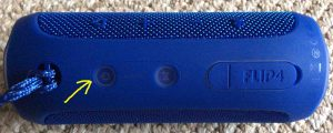 Picture of the JBL Flip 4 Bluetooth speaker in OFF state. Showing the Power button highlighted with yellow arrow.