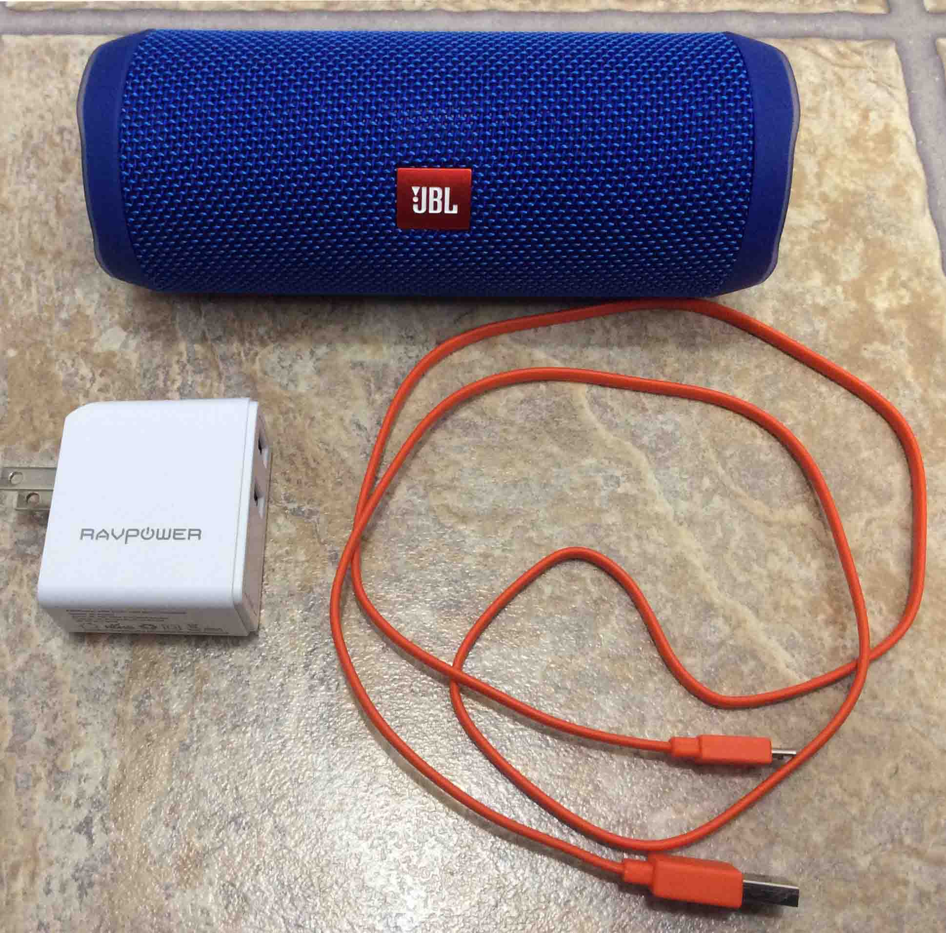 8333a7c29a1 JBL Flip 4 portable speaker with a RavPower USB charger and micro USB charge  cable.