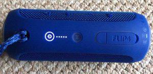 JBL Flip 4 reset. Picture of the JBL 4 Flip series speaker, top view, powered ON.