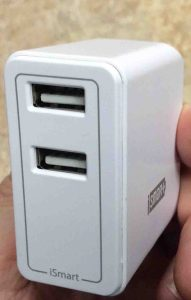 Picture of the RavPower USB dual port 24w wall charger, showing its USB port side.