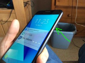 How to restart TracFone Samsung Galaxy J7 Sky Pro Android phone. How to install SD card in Samsung Galaxy J7 Tracfone. Picture of the Samsung Galaxy J7 Sky Pro smart phone, right side view, showing Power-Wake-Sleep button highlighted.