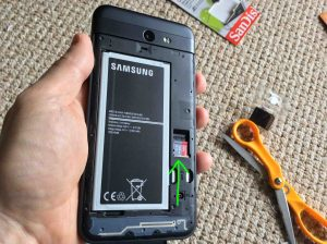Picture of the Samsung Galaxy Sky Pro J7 phone, back view, showing installed Micro SD memory card and battery.