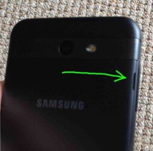 Picture of the Samsung J7 Galaxy phone, showing back cover with its release to open slot highlighted.