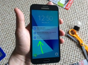 Picture of the TracFone Samsung Galaxy J7 Sky Pro phone. Showing its lock screen after power up, with the new SD card installed notification highlighted.