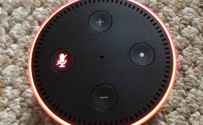 Picture of the Amazon Alexa Echo Dot Gen 2 smart speaker with its Mic OFF, muted, showing the glowing red light ring.