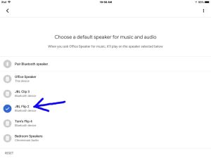 Screenshot of the Google Home app on iOS, showing its -Choose a Default Speaker- screen, with the JBL Flip 2 Bluetooth speaker checked and highlighted.