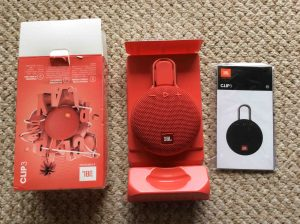 JBL Clip 3 portable wireless Bluetooth speaker picture gallery. Picture of the JBL Clip 3 portable speaker package, unpacked, showing its contents.