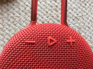 Picture of the JBL Clip 3, front view, showing the Play-Pause and Volume buttons. JBL Clip 3 waterproof Bluetooth speaker review specs features.