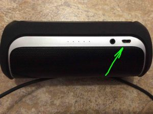 Picture of the JBL Flip 2 portable Bluetooth speaker, showing USB charge port highlighted. JBL Flip 2 review, portable Bluetooth speaker, specs, features.