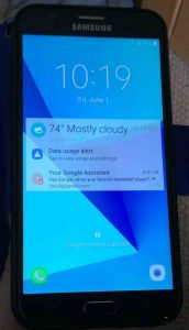 Picture of the TracFone Samsung Galaxy J7 Sky Pro phone, showing its lock screen.