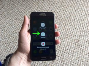 Picture of this smart phone, showing its -Power Options- screen, with the -Restart- button highlighted. How to Reboot Samsung Galaxy J7.