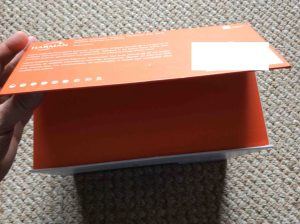 JBL Charge 3 waterproof wireless Bluetooth speaker picture gallery. Picture of the JBL Charge 3 Bluetooth wireless speaker box. Showing opening of the package flap.