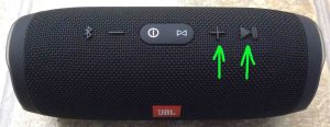 Where is JBL Charge 3 Bluetooth speaker reset button located? Picture of the JBL Charge 3 IPX7 speaker, showing its Volume Up and Play Pause buttons highlighted.