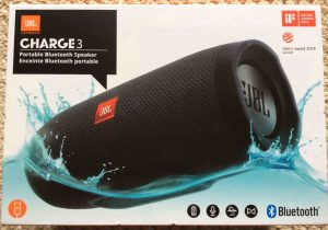 Picture of the JBL Charge 3 portable Bluetooth speaker, original box, side 1. JBL Charge 3 power bank Bluetooth speaker review, features, specs.
