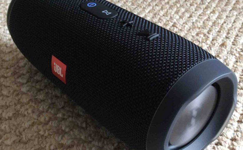 Picture of the JBL Charge 3 portable wireless speaker. Showing the front right end view. The Bluetooth speaker is powered on and paired.