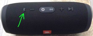 JBL Charge 3 how to pair with iOS devices. Picture of the JBL Charge 3 Bluetooth speaker, powered On, not paired. Showing its Bluetooth discovery mode button highlighted.