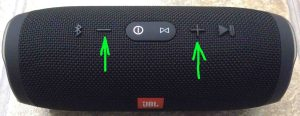 How to adjust volume on JBL Charge 3 Bluetooth speaker. Picture of the JBL Charge 3 speaker, top view, with Volume UP and DOWN buttons highlighted.