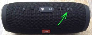 JBL Charge 3 buttons layout guide. Picture of the JBL Charge 3 waterproof portable speaker. Showing its Play-Pause button highlighted.
