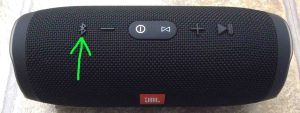 Picture of the JBL Charge 3 wireless speaker with its Bluetooth Discovery Mode button highlighted. JBL Charge 3 buttons.
