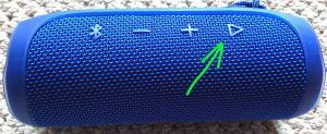 Picture of the JBL Flip 4 waterproof Bluetooth speaker with its Play Pause button highlighted.