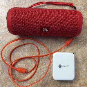 Picture of the JBL Flip 3 battery operated speaker, with its USB charging cable along with an iClever 3 port USB wall charger. How to Charge JBL Flip 3 splashproof Bluetooth speaker.
