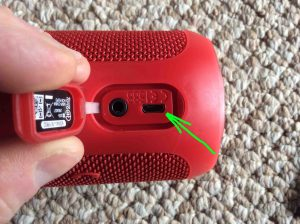 Picture of the JBL Flip 3 splashproof Bluetooth speaker, showing its USB charge port highlighted. How to Charge JBL Flip 3 splashproof Bluetooth speaker.