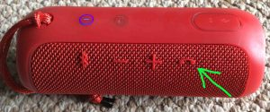 Picture of the JBL Flip 3 splashproof speaker, showing the -Phone Play Pause- button highlighted. JBL Flip 3 buttons layout.