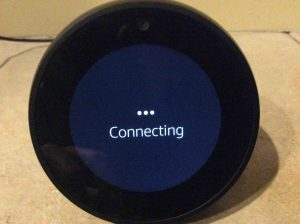 Picture of the speaker, displaying its Connecting screen, while it attempts to connect to the current WiFi network.
