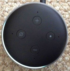 Picture of the Amazon Alexa Echo Dot 3rd gen speaker light ring, showing set at one quarter volume. Echo Dot 3 buttons.