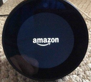 Picture of the Amazon Echo Spot speaker booting, showing the Amazon logo screen. Factory reset Alexa.