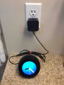 Picture of the power supply adapter for the Amazon Echo Spot speaker, plugged Into a wall outlet.
