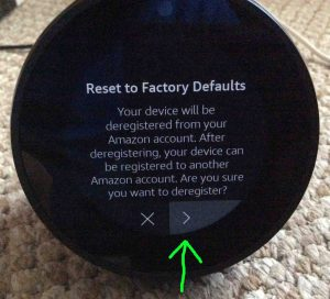 Picture of the Amazon Echo Spot talking speaker, displaying its Reset To Factory Defaults screen, with the Yes-Continue button highlighted.