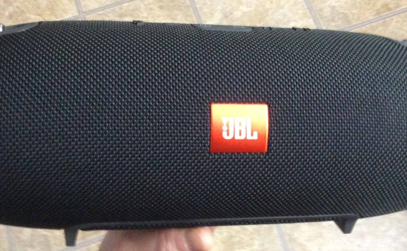 Picture of the JBL Xtreme Bluetooth speaker, front view, held in hand.