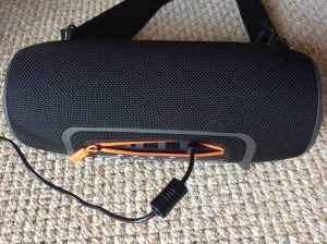 Picture of the Xtreme JBL speaker back view, showing the DC charging cord inserted.