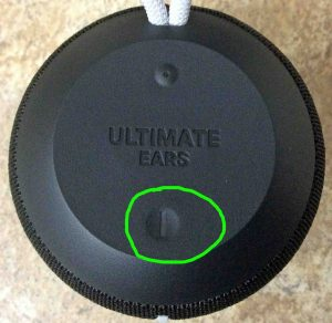 Picture of the UE Wonderboom speaker powered OFF, top view, showing the -Power- button circled.
