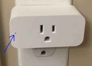 Picture of the Amazon Smart Plug, powered up, showing its dark pilot lamp highlighted.