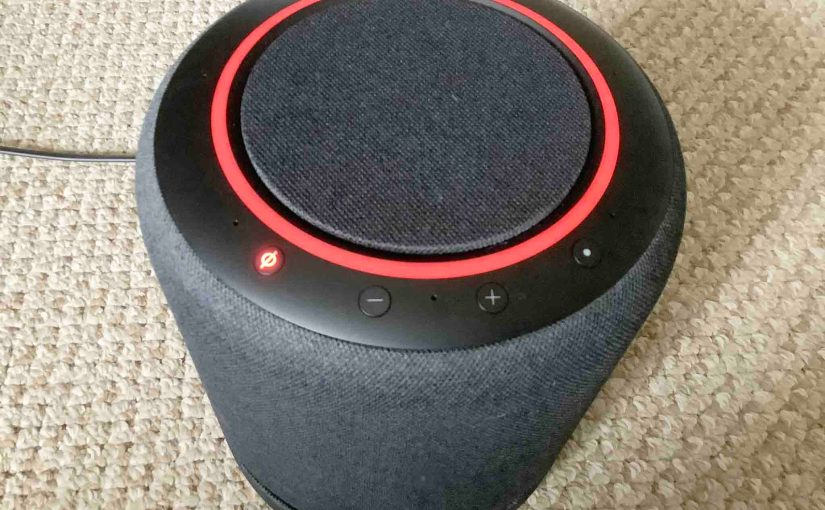 Picture of the red glowing light ring on the Echo Studio Alexa speaker.