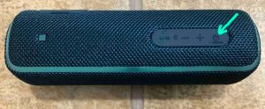 The -Power- button on the Sony SRS XB21 speaker.