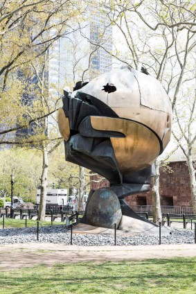 This was originally in the lobby of the WTC. It was found and installed at Battery Park, still with damage from the building's collapse