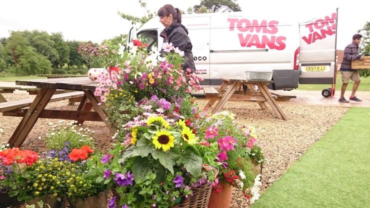 Tom's Vans Removals and Deliveries Bath delivering flower at a local event