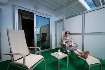 Val enjoying a C-deck balcony (actually on Ventura)