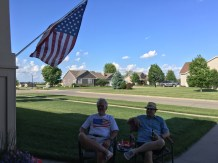 Front lawn, flag flying, food off the grill, cold bevies, and good friends.