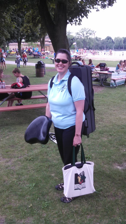 A photograph of Lori with most of her summer band gear